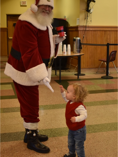 Little_One_Greets_Santa_at_Breakfast